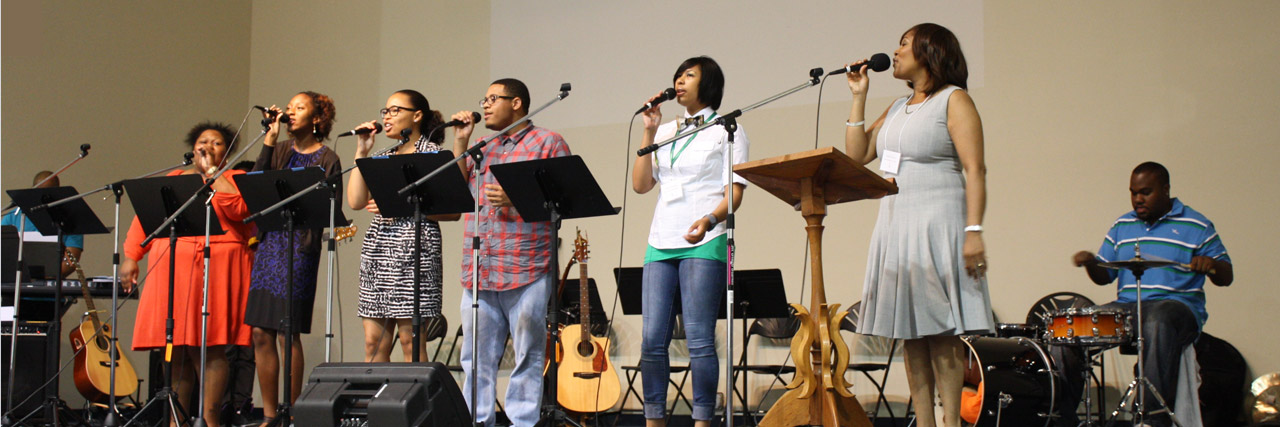 At Assembly in 2012, Conference-goers were blessed by a variety of music styles and lots of singing. At right, Natalie Francisco leads worship songs.