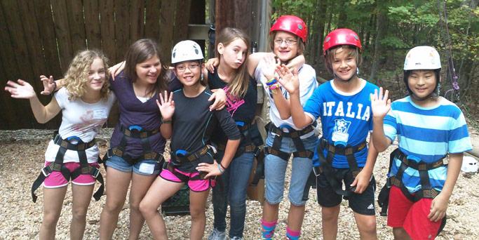 Middle School Retreat participants enjoy a climbing/rappelling activity. Courtesy of Wendy Hostetter Davis
