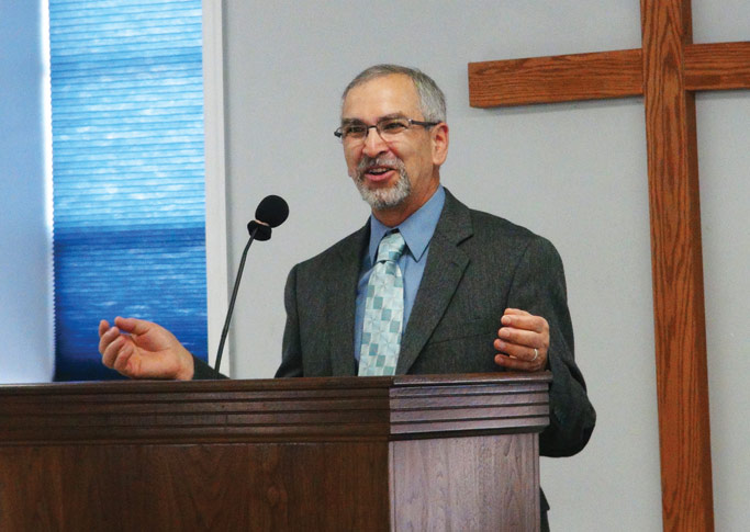 Earl Zimmerman speaks at his installation service at Northern Virginia Mennonite Church. Courtesy photo