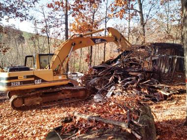 Partners Excavating demolishes the damaged structure. Photo: Jaime Miller Gonzalez