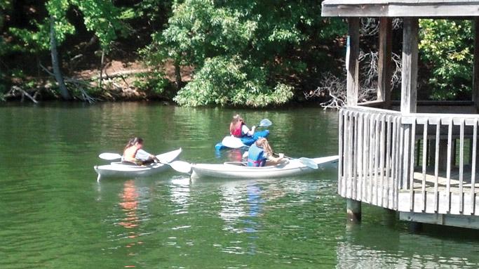 Youth enjoy kayaking in Smith Mountain Lake.