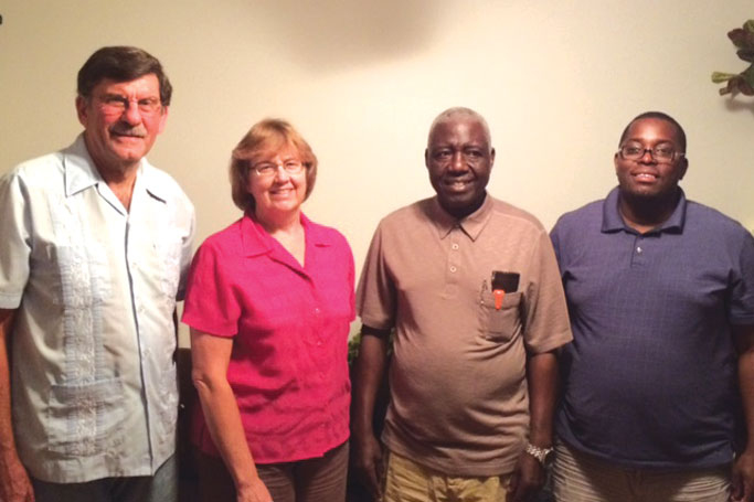 James and Aldine Musser with Bishop John Nyagwegwe and his son, Alberto Othuon. Courtesy of author