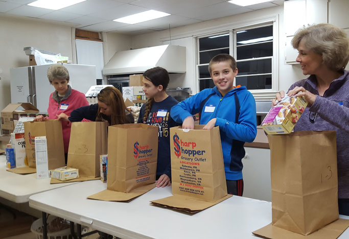 Volunteers from Zion Mennonite Church bag groceries for pantry clients. From left to right: Jennifer Showalter, Emma Resto, Jessica Showalter, Evan Bert, Dawn Nyce. Photo courtesy of Jennifer Ulrich