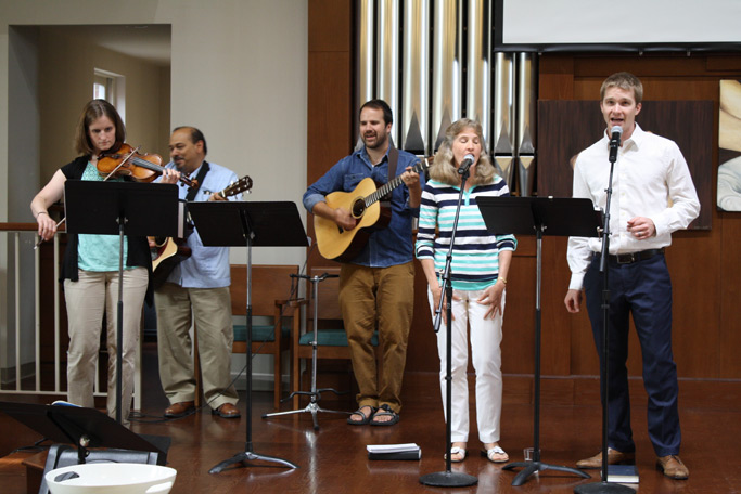The worship team leads the evening service in song.
