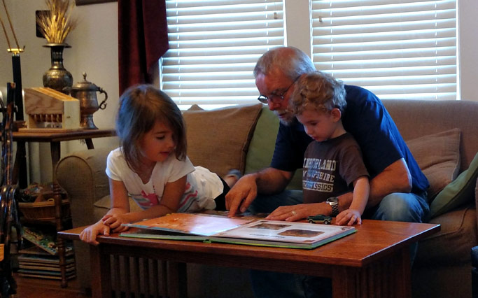 Phil Kniss spends time with two of his grandchildren during his sabbatical. Photo courtesy of Phil Kniss