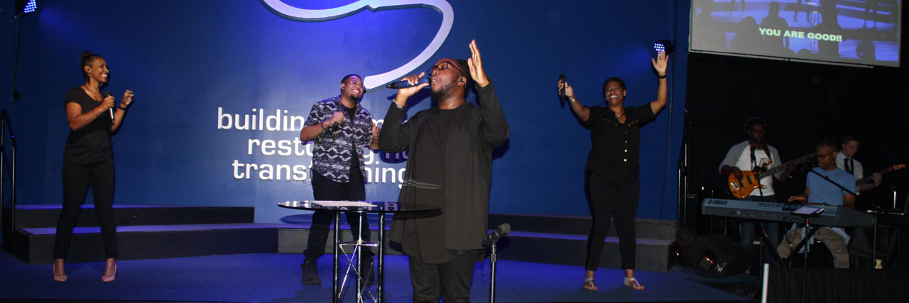 The C3 worship team leads a time of singing at Conference Assembly