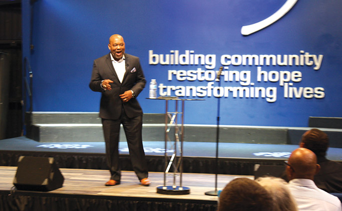 """Glen Guyton speaks at Virginia Mennonite Conference Assembly at C3 Hampton (Calvary Commity Church) on July 20, 2018. His message, We Have Seen the Lord, during evening worship emphasized the transformative faith we carry as individuals and as the church. """"First and foremost, we are a people of faith,"""" he said. Photo: Jon Trotter"""