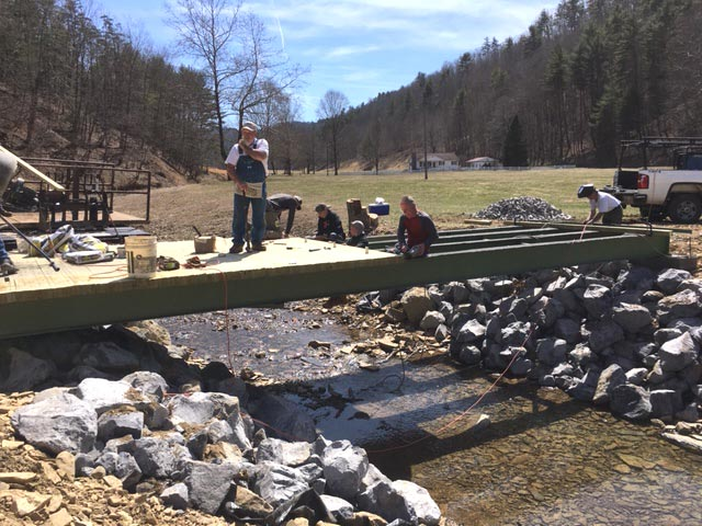After the devastating floods in West Virginia in 2016, Community Mennonite MDS volunteers built new bridges. Courtesy of Sam Miller