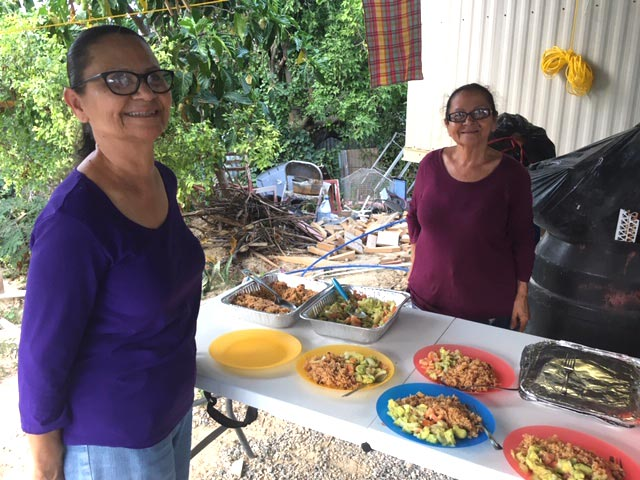 Women in Puerto Rico serve food to the Community Mennonite Church MDS volunteers rebuilding after Hurricane Maria in 2018. Courtesy of Sam Miller