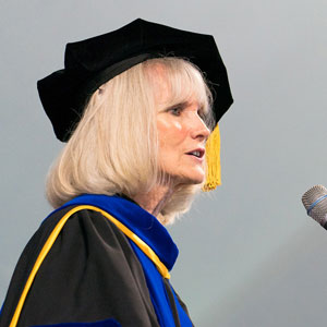 Retiring psychology professor Judy Mullet speaks to graduates at the 2019 commencement ceremony. EMU photo