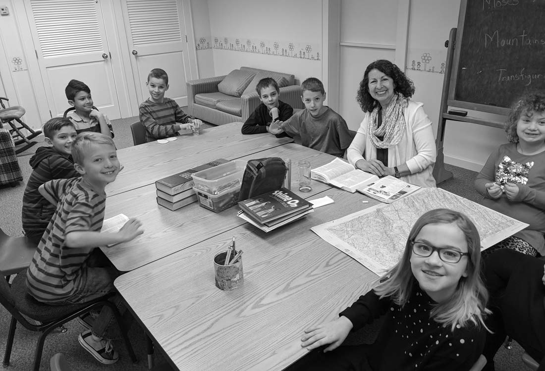 Joy Yoder, Sunday school teacher at Zion Mennonite Church for the past thirty years, with her second and third grade class, February 3, 2019. Elwood Yoder photo