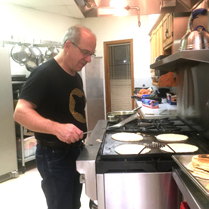 Pastor Clair Good cooks pancakes for WARM. Waynesboro Mennonite Church hosts the shelter one week a year. Photo courtesy of Clair Good