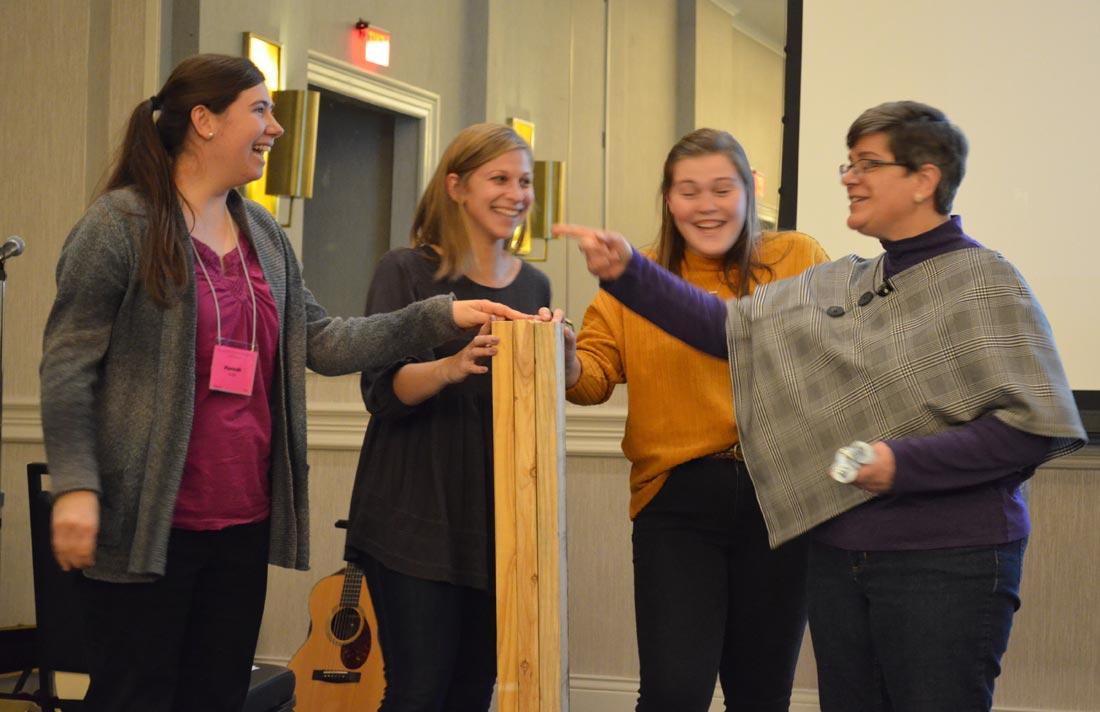 """Deb Horst (right) demonstrates the importance and value of """"sistering"""" in our relationships with (from left) Hannah Shultz, Rachel Yoder, and Katie Liskey. Courtesy of Deb Pardini"""